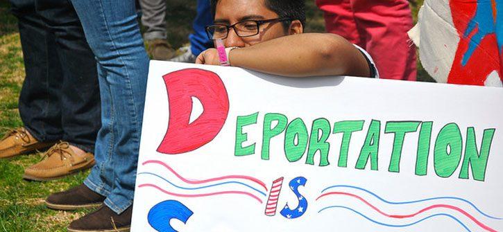 man-holding-deport-sign